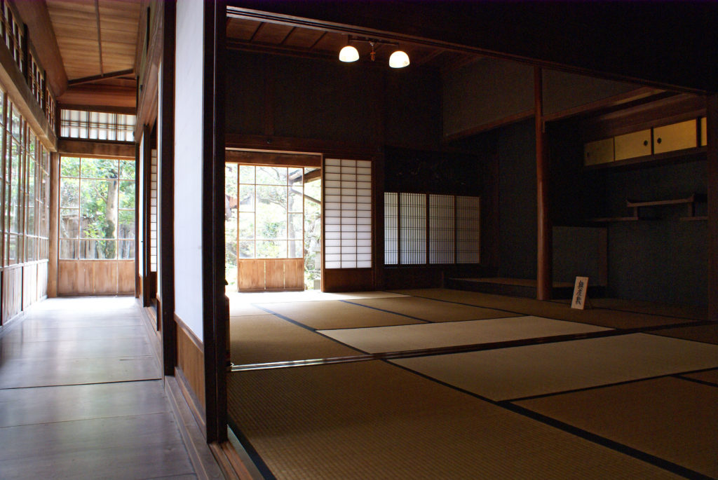 A tatami room surrounded by paper shōji.